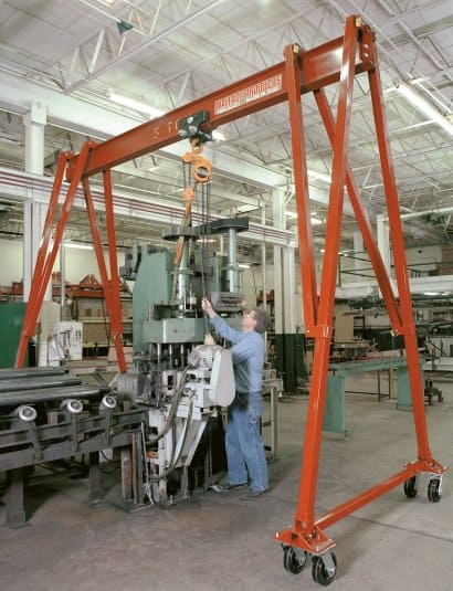 Wallace Cranes - One of our tri-adjustable gantry cranes is shown being used in our warehouse.